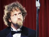English: Josh Blue, American comedian.