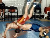 Head over heels, Senior Airman Jeffery Cervone of Peterson Air Force Base, Colo., throws Staff Sgt. David Laymon of Security Battalion, Marine Corps Base Quantico, Va., in a 54-kilogram Greco-Roman wrestling match. Cervone defeated Laymon, 8-2, March 17 a