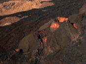 English: A volcanic vent and lava flows from various eruptions on the flank of Mauna Loa, photographed from a helicopter.