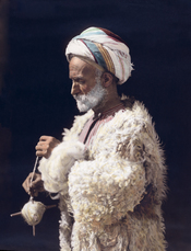 Ramallah man spinning wool. Hand colored photographic print.