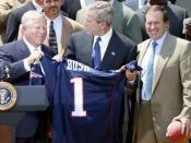 New England Patriots owner Bob Kraft (left), U.S. President George W. Bush (center), and Patriots head coach Bill Belichick during a photo opportunity with the Super Bowl champions in the Rose Garden on May 10, 2004. (Cropped from an original White House