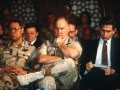 Paul Wolfowitz, under secretary of defense for policy, right, takes notes while Gen. Colin Powell, chairman, Joint Chiefs of Staff, and Gen. Norman Schwarzkopf, Jr., commander-in-chief, U.S. Central Command, listen to Secretary of Defense Dick Cheney answ