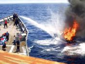 Sailors on USS Rentz (FFG 46) combat a fire set by narcotics smugglers trying to escape and destroy evidence.