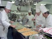 English: White House chefs, directed by Executive Chef Henry Haller, prepare for a state dinner honoring Australian Prime Minister Malcolm Fraser. The chefs are working in the White House kitchen; the dinner occured in 1981, during the administration of R