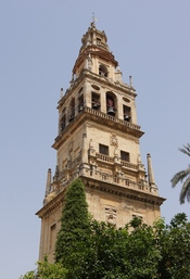 The clocktower, former minaret, of the cathedral (former mosque) of Cordoba, Spain. View from the Orange trees Courtyard.