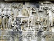 Prince Siddharta Gautama shaves the hair off his head as the sign to decline his status as ksatriya (warrior class) and become sn ascetic hermit, his servants holds his sword, crown, and princely jewelry while his horse Kanthaka stood on right. Bas-relief