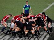 A rugby union scrum between the British and Irish Lions and the All Blacks.