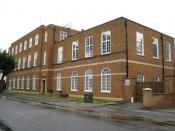 English: Newmarket: Telephone exchange and postal delivery office This 1950s building in The Avenue dates from the time when the General Post Office was responsible for both postal and telecommunications services, and built this structure to house its req