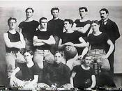 English: First basketball team at the University of Kansas, 1899. Coach James Naismith is on the far right.