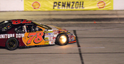 NASCAR driver Joe Nemechek with his brakes on fire at the fall race at Texas.