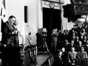 English: Gamal Abdel Nasser takes presidential oath for his third term as president, behind him vice-president Sadat.