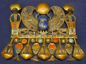 English: Winged scarab of Tutankhamun with semi-precious stones. This pectoral is composed of Tut's Prenomen name: