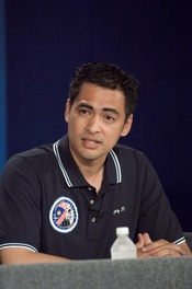 Malaysian spaceflight participant responds to a query from the media during an pre-flight press conference at the Johnson Space Center.