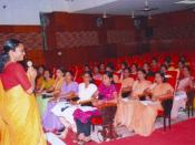 Ms Sarada Muraleedharan, Director, Kudumbashree is training a group on performance improvement
