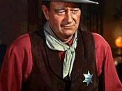 Cropped screenshot of John Wayne and Angie Dickinson from the trailer for the film Rio Bravo