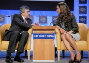 DAVOS/SWITZERLAND, 25JAN08 - Gordon Brown, Prime Minister of the United Kingdom and H.M. Queen Rania Al Abdullah of the Hashemite Kingdom of Jordan, Member of the Foundation Board of the World Economic Forum, talk to each other during the session 'Corpora