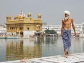 Sikh pilgrim at the Harmandir Sahib (Golden Temple) in Amritsar, India. The man has just had a ritual bath.