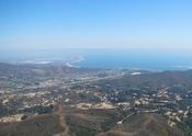 English: Ventura, viewed from the northwest; the Ventura/San Miguelito Oil Field is in the foreground (July 31, 2009).