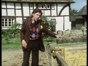 David Dixon as Ford Prefect in Episode One of the TV adaptation of The Hitchhiker's Guide to the Galaxy