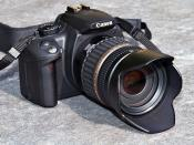 This image shows a Canon EOS 350D digital single-lens reflex camera with a Tamron 18-200 f/3.5-6.3 XR Di II LD lens. Thanks to Andreas Böttger for allowing me to make this photo.