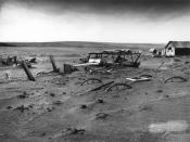 English: Buried machinery in barn lot in Dallas, South Dakota, United States during the Dust Bowl, an agricultural, ecological, and economic disaster in the Great Plains region of North America in 1936