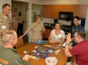 US Navy 110729-N-HJ915-082 Rear Adm. Elizabeth Niemyer, center, monitors a gaming group session in the Activities of Daily Living apartment at Nava