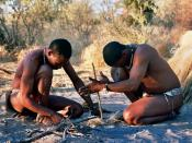 Bushmen in Deception Valley, Botswana demonstrating how to start a fire by rubbing sticks together.