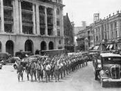 English: Battle of Singapore, February 1942. Japanese victorious troops march through the city centre.