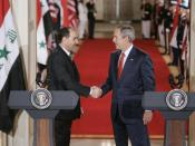 President George W. Bush shakes hands with Iraqi Prime Minister Nouri al-Maliki at the conclusion of their joint press availability in the East Room of the White House Tuesday, July 25, 2006.