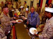 U.S. President George W. Bush meets with troops and serves Thanksgiving Day Dinner at the Bob Hope Dining Facility, Baghdad International Airport, Iraq,, Nov. 27.2003 (http://www.defenselink.mil/news/newsarticle.aspx?id=27709)