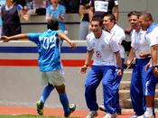 Enrique Meza, Jr. and others rejoicing with his Under 17 Team player who scored a goal for Cruz Azul