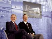 President George W. Bush and former President George H.W. Bush sit on stage at the U.S. Embassy in Beijing Friday, Aug. 8, 2008, during dedication ceremonies. Both are scheduled to attend opening ceremonies scheduled for later in the evening.