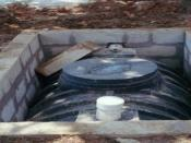 The same tank partially installed in the ground
