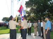 US Navy 100818-N-3436L-002 Sailors raise the new Occupational Safety and Health Administration (OSHA) flag for achieving OSHA's Voluntary Protection Program