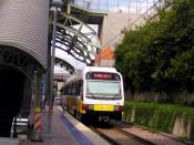 A northbound light rail train at the Mockingbird Station