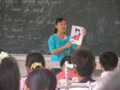 Student teacher in China teaching children English.