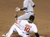 Cincinnati Reds second baseman Brandon Phillips (4) and Baltimore Orioles center fielder Adam Jones (10)