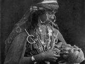 original National Geographic article A BEDOUIN MOTHER AND CHILD. The father of this little nomad may be a warlike bandit with a cloudy notion of property rights and other details of the civilized code; his mother a simple daughter of the desert with a chi