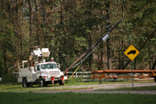 English: Evadale, TX, Oct 2. 2005 -- Utility companies are working overtime to re-establish power and utilities. Bob McMillan/ FEMA Photo