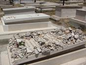 English: Side view of grave of Oskar Schindler in the Mount Zion Franciscan Cemetery, Jerusalem. His is the only grave piled with stones, a custom usually seen only in Jewish cemeteries, indicating the many Jewish visitors to his gravesite.