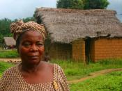 Sierra Leone - Njama village, Kailahun District. This woman has such dignity and strength in her expression. She clearly knows a thing or two about life, having lived through a 10 year civil war.