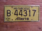 ALBERTA JUN30-84 LATE ISSUE STICKER ---MOTORCYCLE PLATE