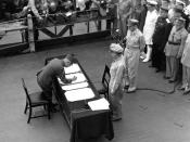 Umezu signing the instrument of surrender to the United States