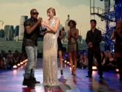West taking the microphone from Swift at the 2009 MTV Video Music Awards.