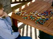 English: People with Asperger's Syndrome are often preoccupied with particular, specialized areas of knowledge, such as this boy's interest in molecular structure.
