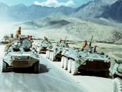 Soviet troops (in right row) withdrawing from Afghanistan in 1988. Afghan government BTR on the left.