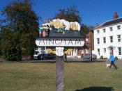 English: Hingham town sign. Hingham is a beautiful small market town with links with Hingham MA in the US due to emigration.