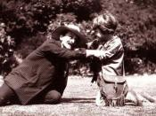 J. M. Barrie (as Hook) and Michael (as Peter Pan) on the lawn at Rustington, August 1906