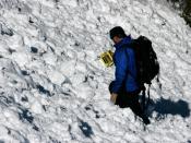 English: Rescuer using RECCO R9 detector on training drill in Colorado.