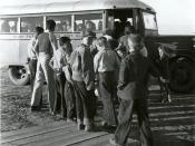 Migratory cotton pickers' children from an FSA mobile camp for migratory laborers boarding a school bus to the district school. Taken in Pinal County, Arizona, United States.